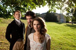 "JJ Feild as Mr. Henry Nobley, Bret McKenzie as Martin and Keri Russell as Jane Hayes in ""Austenland."""