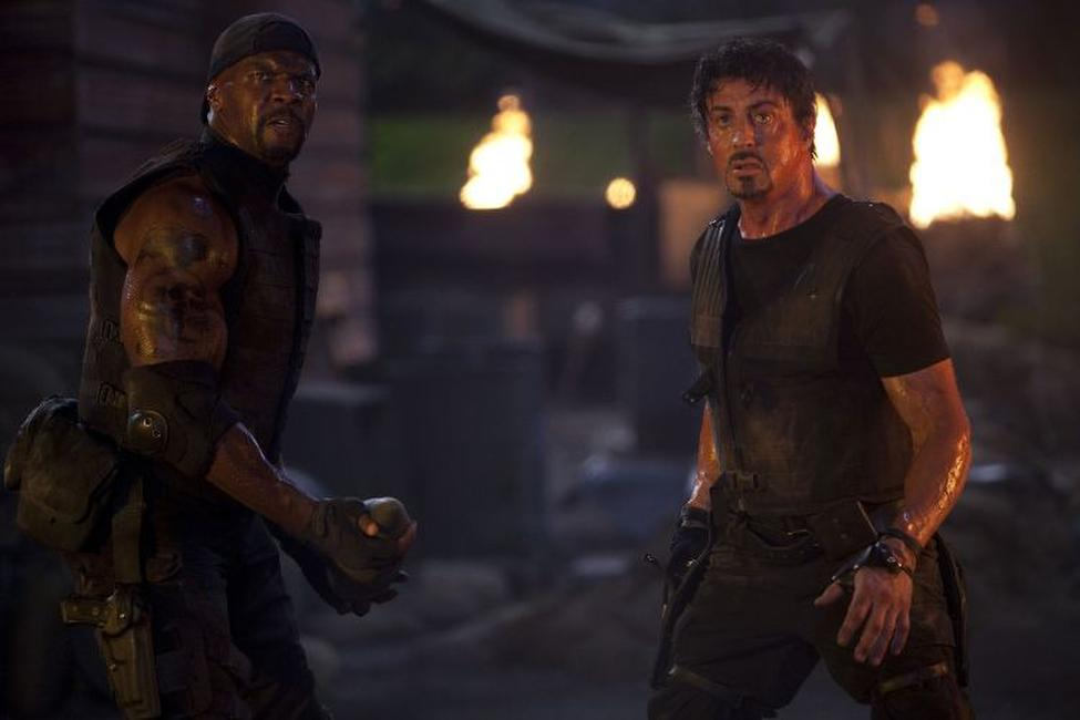 Terry Crews as Hale Caesar and Sylvester Stallone as Barney Ross in