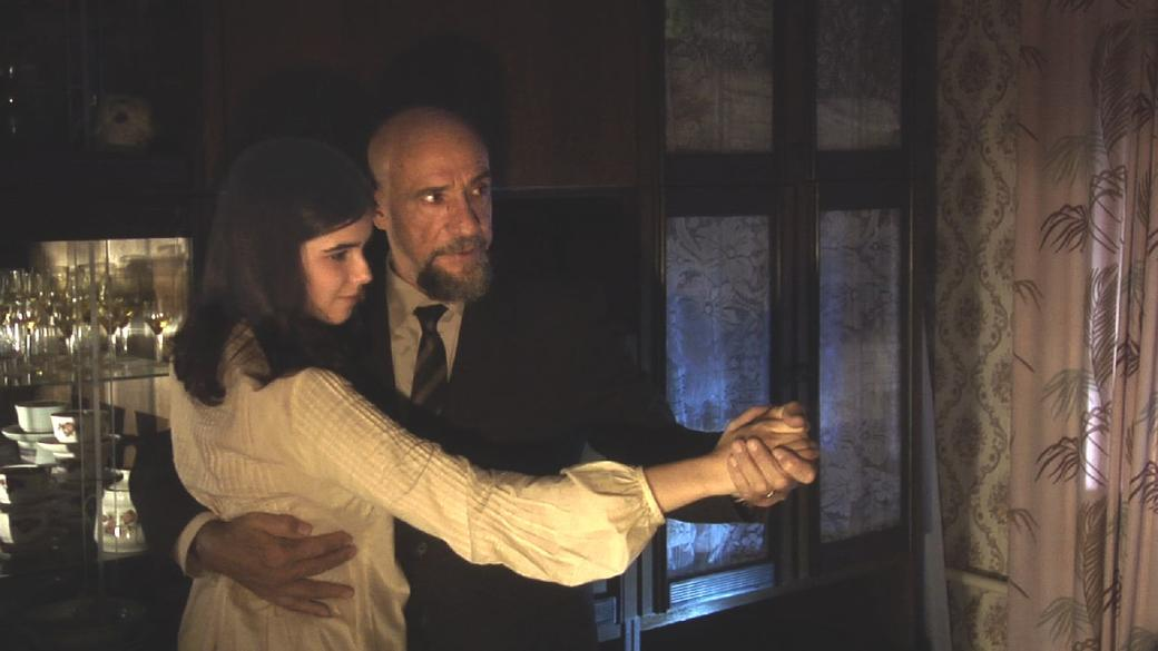 F. Murray Abraham as Gross and Maria Andreyeva as Elena in
