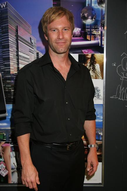 Aaron Eckhart at the Olympus Fashion Week.