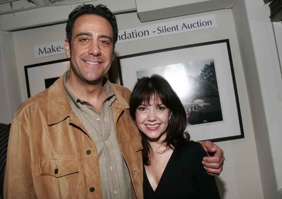 Brad Garrett and Kelli Seely at a gallery exhibition of photographer Slim Aarons.