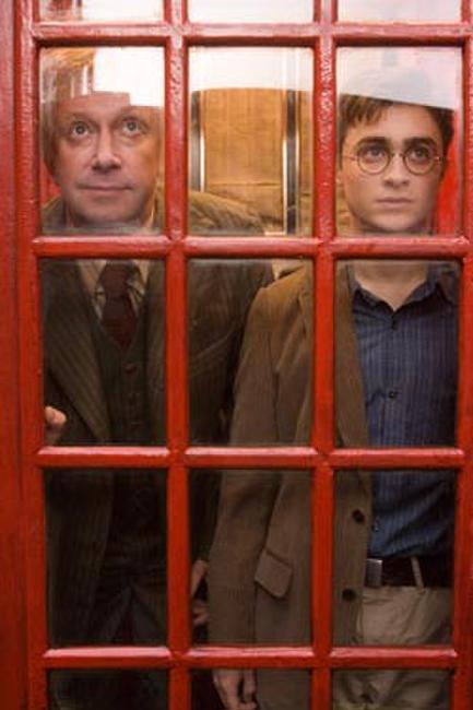 Mark Williams as Arthur Weasley and Daniel Radcliffe in