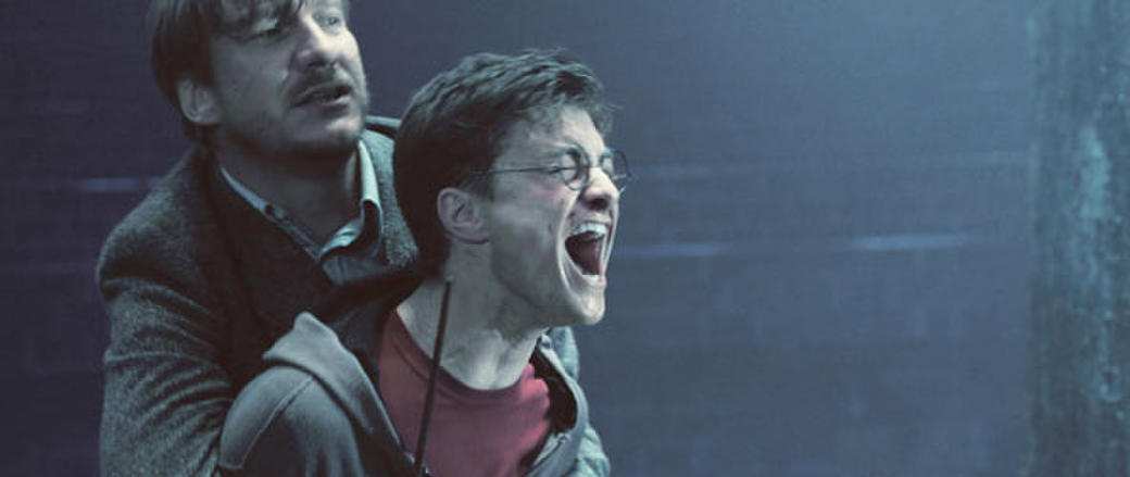 David Thewlis as Remus Lupin and Daniel Radcliffe in