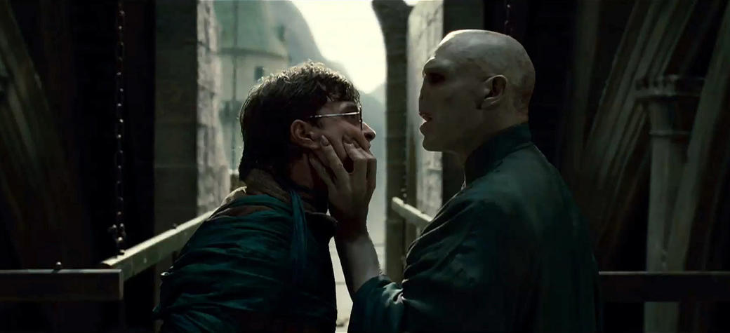 "(L-r) Daniel Radcliffe as Harry Potter and Ralph Fiennes as Lord Voldemort in Warner Bros. Pictures' fantasy adventure ""Harry Potter and the Deathly Hallows: Part I."