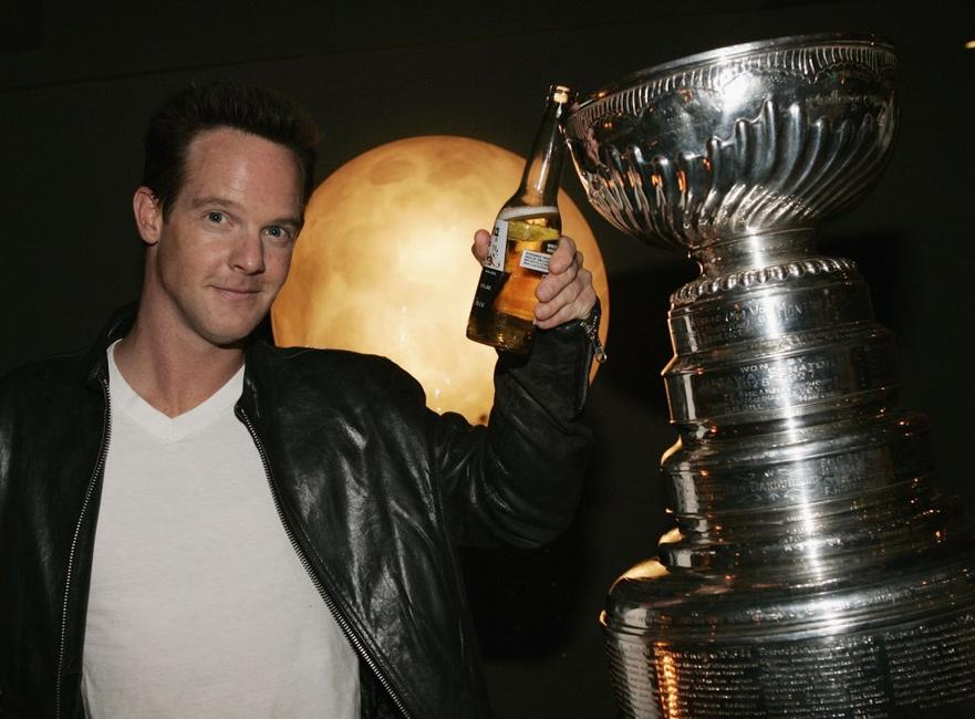 Jason Gray-Stanford poses with the NHL Stanley Cup at Republic Restaurant.