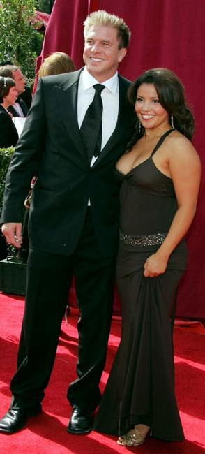 Kenny Johnson and Justina Machado at the 57th Annual Emmy Awards.