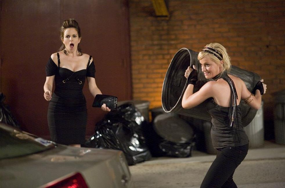 Tina Fey as Kate Holbrook and Amy Poehler as Angie Ostrowiski in