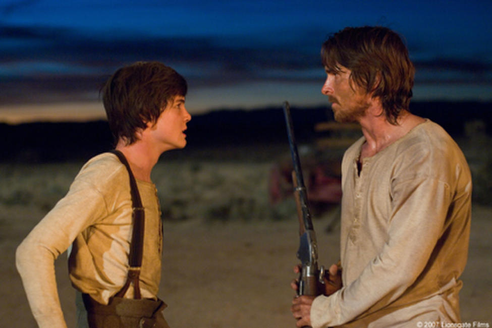 William Evans (Logan Lerman) and Dan Evans (Christian Bale) in