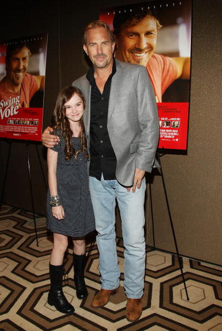 Madeline Carroll and Kevin Costner at the screening of