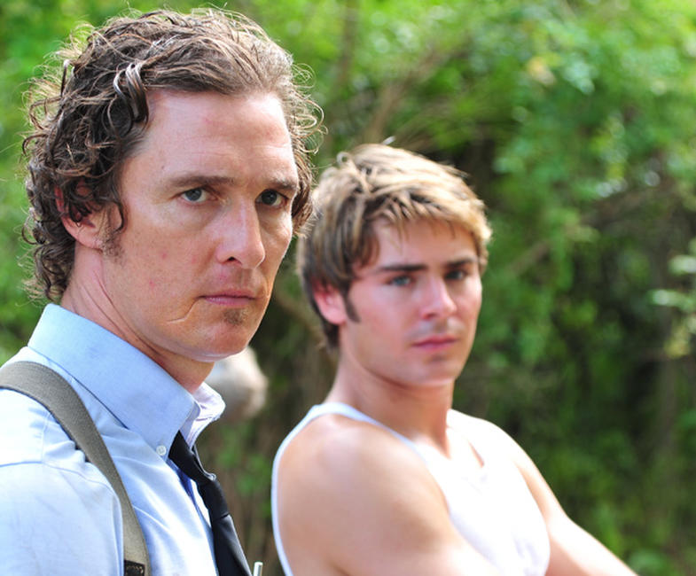Matthew McConaughey as Ward Jansen and Zac Efron as Jack Jansen in