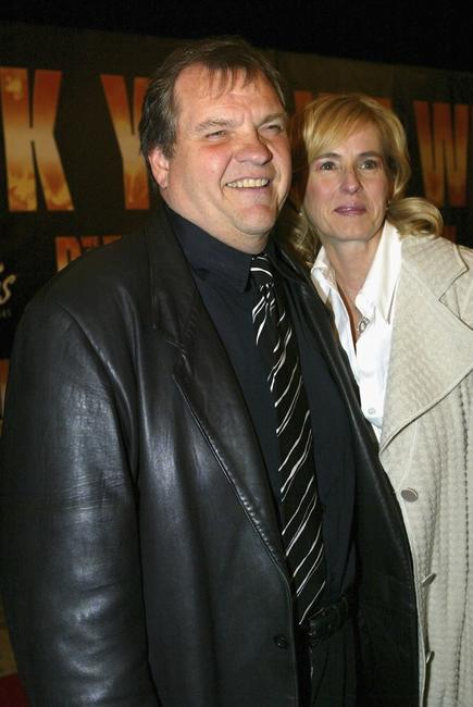 Meatloaf and guest arrive at the premiere of