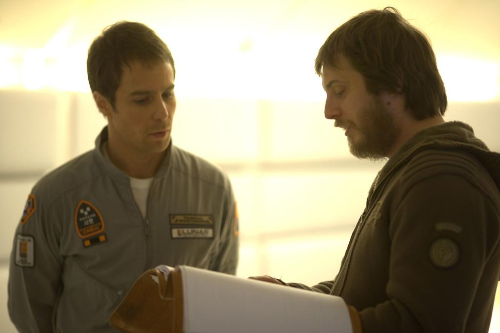 Sam Rockwell and Director Duncan Jones on the set of