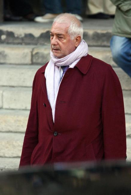Jean-Claude Brialy at the Sainte-Clotilde basilica for the funeral mass for French actor Philippe Noiret.