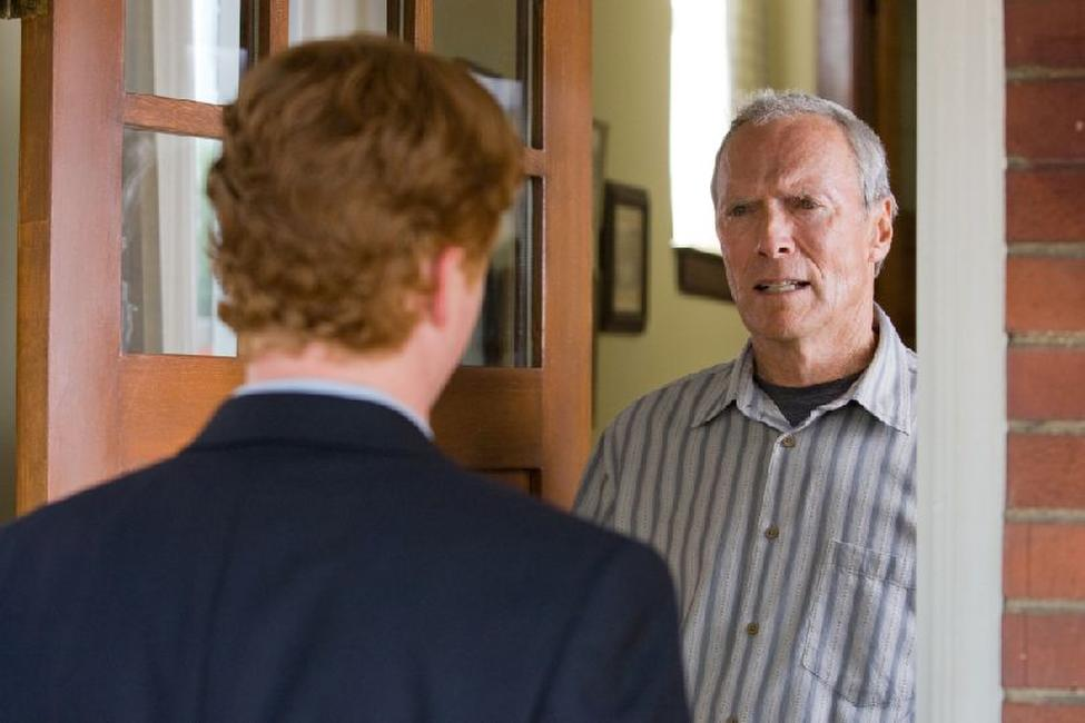 Christopher Carley as Father Janovich and Clint Eastwood as Walt Kowalski in