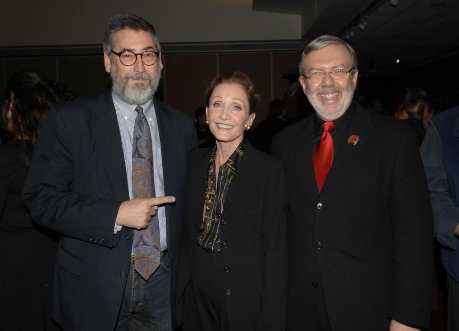 John Landis, Gretchen Wayne and Leonard Maltin at the premiere of