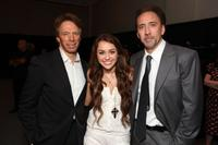 Producer Jerry Bruckheimer, Miley Cyrus and Nicolas Cage at the opening Ceremony of Disney's Inaugural D23 Convention.