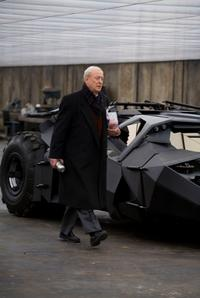 Michael Caine as Alfred in