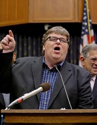 Michael Moore and several members of Congress at the news conference and rally ahead of the release of Moore's new movie