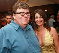 Michael Moore and Meghan O'Hara at the afterparty for a special screening of
