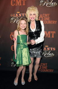 Dakota Fanning and Dolly Parton at the Country Music Television's CMT Giants honoring Reba McEntire.