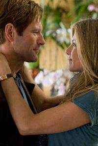 Aaron Eckhart as Dr. Burke Ryan and Jennifer Aniston as Eloise Chandler in