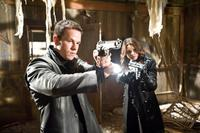 Mark Wahlberg as Max Payne and Mila Kunis as Mona Sax in