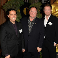 Director Lee Unkrich, producer John Lasseter and Andrew Stanton at the 83rd Academy Awards in California.
