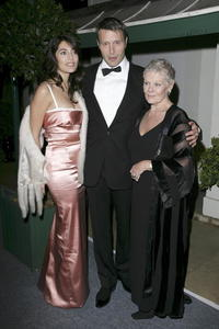 Caterina Murino, Mads Mikkelsen and Dame Judi Dench at the after party of