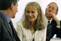Mia Farrow, David Rubenstein and Lawrence Rossin at the National Press Club for news conference Save Darfur Coalition.