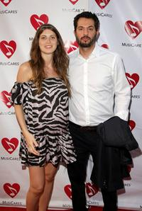 Guy Oseary and Guest at the 5th Annual MusiCares MAP Fund Benefit Concert.