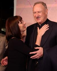 Gene Hackman and Anjelica Huston hug at the premiere of the film