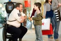 Kevin James as Paul Blart and Dylan Clark Marshall as Jacob in