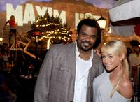 Craig Robinson and Guest at the 11th Annual Maxim Hot 100 party.
