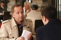 Fabrice Luchini as Roland Verneuil and Xavier Robic as Arthur Delamare in