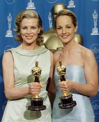 Kim Basinger and Helen Hunt at the 70th Annual Academy Awards at the Shrine Auditorium in Los Angeles.