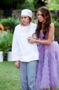 Carly Chaikin and Miley Cyrus in