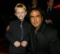 Nathan Gamble and Director Alejandro Gonzalez Inarritu at the premiere of