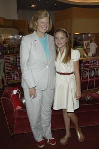 Valerie Tripp and Madison Davenport at the signing of