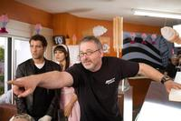 Clive Owen, Monica Bellucci and director Michael Davis on the set of