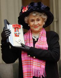 Joan Plowright poses for picture after being made a Dame by the Prince Of Wales at Buckingham Palace in London.
