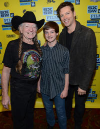 Musician Willie Nelson, Chandler Canterbury and musician Harry Connick Jr. at the Texas premiere of