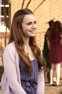 Lily Collins as Collins in