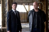 Karl Urban and Bruce Willis in