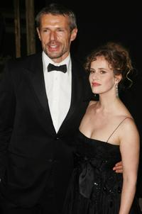 Lambert Wilson and guest at the Cannes Film Festival 60th Anniversary Dinner.