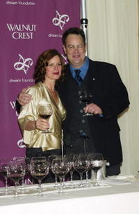 Dan Aykroyd and Marcia Gay Harden at the Walnut Crest Million Dollar Celebrity Wine Challenge.