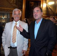 Jean-Paul Belmondo and wife Oliver Stone at the inauguration of the Cinema Festival of Paris.