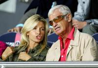 Jean-Paul Belmondo and wife whife Naty at the Parc des Princes stadium in Paris.
