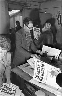Jean-Luc Godard consults in the printing works of the Cause of the People the last number of the newspaper Maoist.