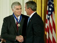 Charlton Heston and U.S. President George W. Bush at an East Room event at the White House.