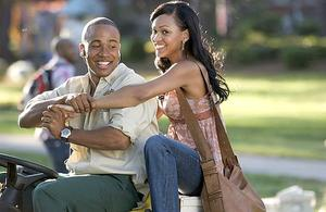 "Columbus Short as DJ and Meagan Good as April in ""Stomp the Yard."""